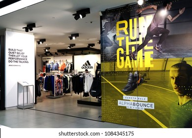 SINGAPORE - APR 22, 2018: Adidas retail store in Marina Bay Sands, Singapore. Adidas is a German corporation that designs footwear and clothing.