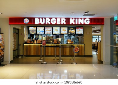 SINGAPORE - APR 22, 2018: Burger King Restaurant in Singapore Shopping mall. Burger King claims to serve more than 11 million guests per day in 91 countries and territories around the world.