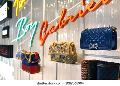 SINGAPORE - APR 22, 2018: Chanel Boutique store front window display at Marina Bay Sands Singapore. It is a high fashion house that specializes clothes, luxury goods and fashion accessories.
