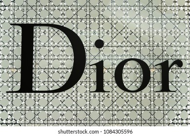 SINGAPORE - APR 22, 2018: Dior logo sign at Marina Bay Sands, Singapore. The company designs and retails ready-to-wear, leather goods, fashion accessories, footwear, jewellery and skincare products.