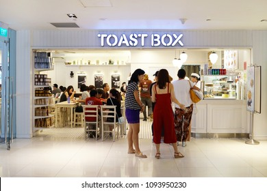 SINGAPORE - APR 22, 2018: Exterior view of Toast Box Cafe in shopping mall Singapore. Toast Box coffee house serving mainly coffee, kaya toast and local Malaysian and Singapore food.