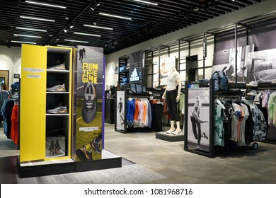 SINGAPORE - APR 22, 2018: Interior of Adidas store in Changi Airport Terminal 4, Singapore. Adidas is a German multinational corporation that designs and manufactures sports clothing and accessories.