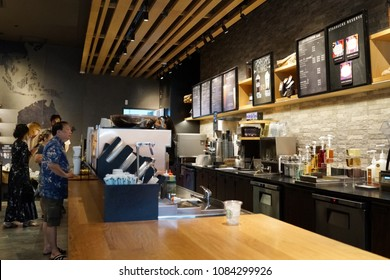 SINGAPORE - APR 22, 2018: Interior of Starbucks store in Marina Bay Sands Shopping Mall, Singapore. Starbucks is the world's largest coffee house with over 20,000 stores in 61 countries.