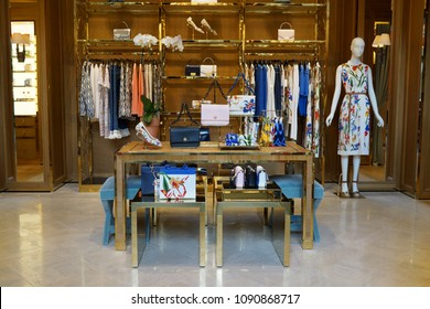 SINGAPORE - APR 22, 2018: Interior of Tory Burch Store Front Sign in Marina Bay Sands Mall. Tory Burch is an American fashion label owned, operated and founded by American designer Tory Burch.