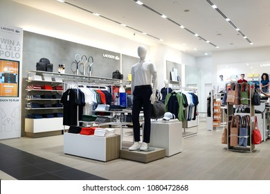 SINGAPORE - APR 22, 2018: Lacoste fashion store in Changi Airport Terminal 4, Singapore. French clothing company founded in 1933 that sells high-end clothing and most famously polo shirts.