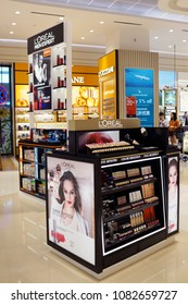 SINGAPORE - APR 22, 2018: Loreal cosmetic store in Changi Airport new terminal 4, Singapore. L'Oréal is a French personal care company headquartered in Clichy. It is world's largest cosmetics company.