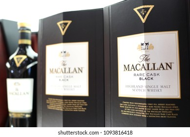 SINGAPORE - APR 22, 2018: Macallan Highland Single Malt Scotch Whiskey on Store Shelf in Changi Airport new Terminal 4. TThe Macallan Distillers is a wholly owned subsidiary of the Edrington Group.