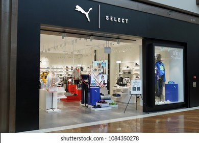 SINGAPORE - APR 22, 2018: Puma fashion store in Marina Bay Sands Mall. PUMA, is a German multinational company that designs and manufactures athletic and casual footwear, apparel and accessories.