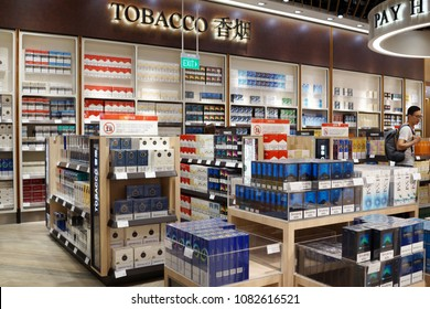 SINGAPORE - APR 22, 2018: Various brand of tobacco on store shelf in Changi Airport Terminal 4. Tobacco use is a risk factor for many diseases, especially those affecting the heart, liver, and lungs.