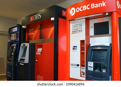 SINGAPORE - APR 22, 2018: Various bank ATMs at Marina Bay Sands shopping Mall, Singapore. ATM is an electronic telecommunications device that enables customers to perform financial transactions.
