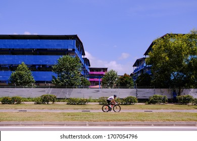 Singapore Apr2020 S11 Dormitory at Punggol; largest cluster of covid-19 cases found at this foreign worker dorm (Circuit breaker period; coronavirus outbreak). Lone cyclist riding past on the PCN.