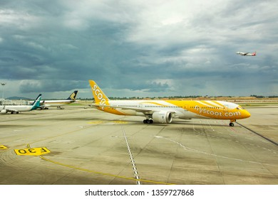 Singapore - April 04 2019: Scoot aircraft approaching at Changi International Airport (SIN) in Singapore. Scoot, Scoot Pte Ltd., is a Singaporean low-cost long-haul airline owned by Singapore Airlines