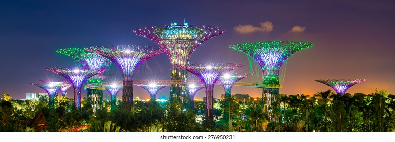 SINGAPORE - APRIL 06: Futuristic view of amazing illumination at Garden by the Bay on April 6, 2013 in Singapore. Night light show at Supertree is main Marina Bay Sands district tourist attraction