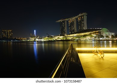 Singapore - April 1, 2018: A bicycle operated by oBike parked near the Merlion Park with view of the Marina Bay Sands. oBike is Singaporean stationless bicycle sharing system.