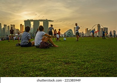 SINGAPORE - April 12 : Tourists watching the sunset at Marina Barrage Singapore on April 12, 2014