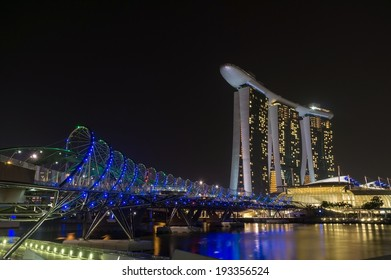 SINGAPORE - APRIL 13: The Marina Bay Sands Resort Hotel link with Helix Bridge on April, 2013 in Singapore. The wold's most expensive standalone casino property.