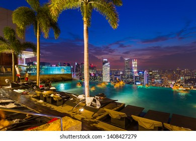 SINGAPORE - APRIL 14: Pool on roof and Singapore city skyline on April 14, 2016 in Singapore.