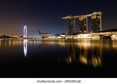 SINGAPORE - APRIL 15, 2017 : Cityscape in dawn time of Marina Bay Sands Hotel in Singapore, Marina bay, Singapore flyer, Art Science Museum are famous landmarks of tourist in Singapore