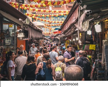 Singapore - April 2, 2018: China town strees in Singapore. People walking around chinese market