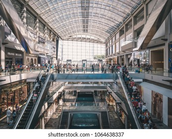 Singapore - April 2, 2018: Shopping mall at Marina Bay Sands. Lots of different boutiques and stores. People passing by. Shopping concept.