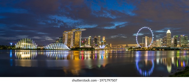 Singapore - April 2021: Wide panorama of Singapore cityscape at dusk.