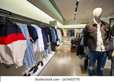 SINGAPORE - APRIL 21, 2019: clothes on display at Zara store in Singapore Changi Airport. Zara is a Spanish apparel retailer, specializes in fast fashion.