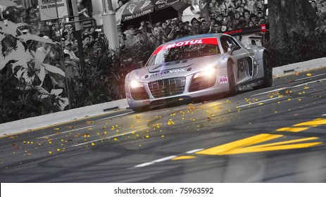 SINGAPORE - APRIL 24: Audi R8 LMS speeds down the road during Red Bull Speed Street Singapore on April 24, 2011 in Singapore.