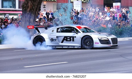 SINGAPORE - APRIL 24: Audi R8 LMS performs burnouts during Red Bull Speed Street Singapore on April 24, 2011 in Singapore.