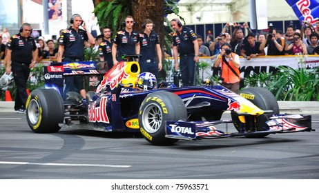 SINGAPORE - APRIL 24: David Coulthard performing donuts in the Red Bull Racing F1 car RB6 during Red Bull Speed Street Singapore on April 24, 2011 in Singapore.