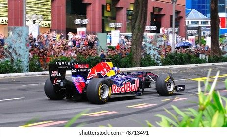 SINGAPORE - APRIL 24: David Coulthard, performing donuts in Redbull Racing Car on the streets of Orchard Road in Red Bull Speed Street Singapore on April 24, 2011 in Singapore.