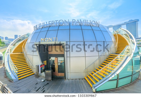 Singapore - April 28, 2018: The Fullerton Pavilion, a glass dome floating on Marina Bay between Clifford Pier and One Fullerton Hotel, is now home to a new Italian restaurant Monti At 1-Pavilion.