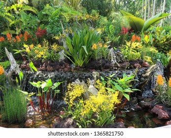 Singapore. April 9, 2019. The stunning entrance of the National Orchid Garden, located wthin the Botanic Gardens, and its display of some of the beautiful orchids that await visitors within.