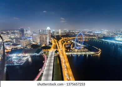 Singapore: Asia 26 February 2018 Singapore skyline at the Marina bay during twilight.Aerial view of Singapore business district Singapore