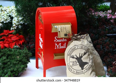 Singapore, Asia - November 29, 2015 - Santa mailbox and mail bag surrounded by Christmas decorations in city holiday display