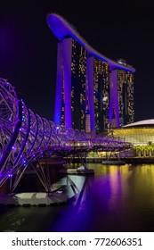 Singapore Asia October 28, 2017 Marina Bay Sands and the Helix Bridge at night
