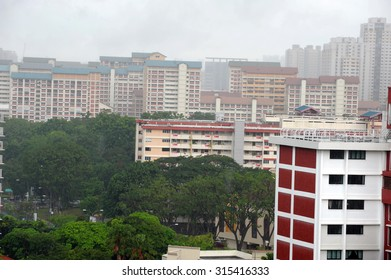 Singapore, Singapore - Aug 08 : High Angle View of public housing during heavy downpour in Singapore in the day on Aug 08, 2015