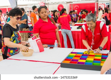 Singapore Aug 10th 2019: National Day Heartlands celebrations in Southwest of Singapore Jurong East area. 2019 is the 54th birthday of Singapore.  People are playing the game for fun during event