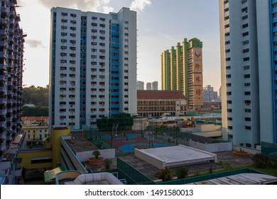 SINGAPORE - AUG 2 2019 HDB flats in Chinatown with Peoples Park Complex in the background. There's also basketball court on the rooftop of a building.