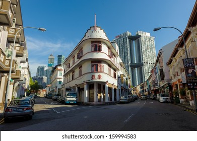 Singapore, Singapore - Aug 30: Singapore heritage buildings in Chinatown against the new skyscraper as backdrop taken on August 30, 2013
