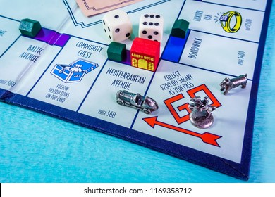 Singapore - Aug 31, 2018:  Monopoly Board Game with the car passing the GO. The classic real estate trading game from Parker Brothers was first introduced to America in 1935.