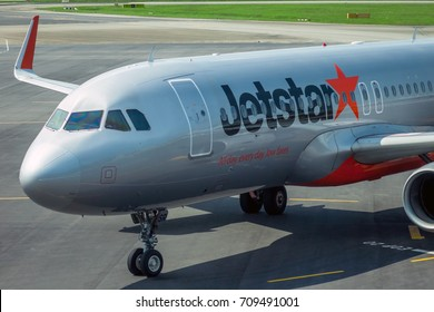 SINGAPORE - AUG. 9 ,2016 : Jetstar aircraft in Changi Airport, Singapore. Jetstar Airways Pty Ltd is an Australian low cost airline headquartered in Melbourne.