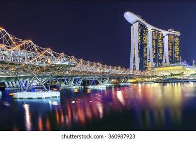 SINGAPORE - AUGUST 04, 2012: The Helix Bridge. Marina Bay Sand iconic design has transformed Singapore's skyline. Designed by architect Moshe Safdie.pore's skyline. Designed by architect Moshe Safdie.