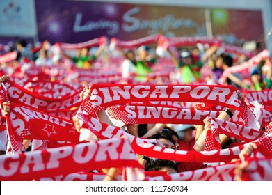 SINGAPORE - AUGUST 09: Sea of Singapore scarves at National Day Parade 2012 on August 09, 2012 in Singapore
