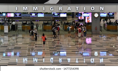 Singapore, Singapore - August 11, 2019: Air travellers pass immigration control at Changi International Airport. Changi is the main aviation hub in SE Asia, handling 70 million passengers annually.
