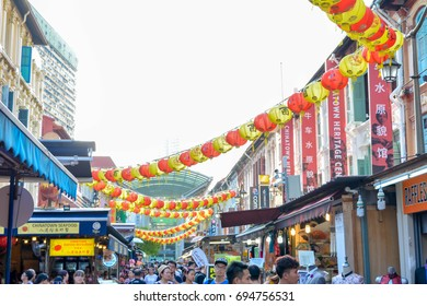 Singapore, Singapore - August 12, 2017: Tourists walking along Singapore china town market unesco heritage