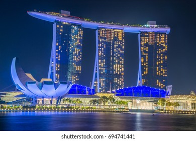 Singapore, Singapore - August  12, 2017: View at the Marina Bay in Singapore at night, which is the iconic landmarks of Singapore.