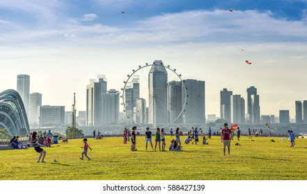 Singapore - August 13rd, 2016: Many People enjoying and playing at Marina Barrage. Marina Barrage is the water-supply place of Singapore and is the park for outdoor activities of Singapore people