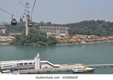 SINGAPORE - AUGUST 15: Cable cars from Singapore to Sentosa Island and back as seen on August 15, 2012. Sentosa has a theme park, sand beach, resort, yacht marina, hotel and luxury residence.