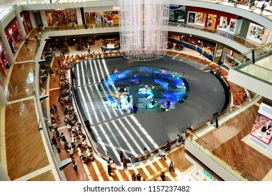 Singapore - August 15th 2018: Aerial view of atrium at Marina Bay Shopping Center with futuristic lighting and play area for children