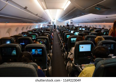 Singapore, Singapore - August 16, 2018 : Inside the economy class in flight of Cathay Pacific Airbus 350-900